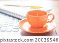Laptop with coffee cup and notepad on desk 20039546
