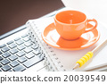 Laptop with coffee cup and notepad on desk 20039549