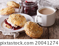 Scones with jam and tea with milk  20041274