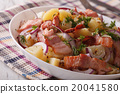 Tasty potato salad with bacon and herbs close up 20041580
