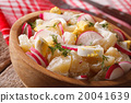 potato salad with radish and eggs close-up 20041639