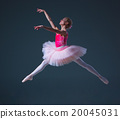 The jump of beautiful female ballet dancer  20045031