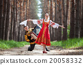 Couple on nature in russian national dress 20058332