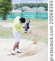 Male golfer hitting golf ball out of a sand trap 20068365