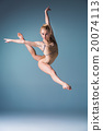 Young beautiful modern style dancer jumping on a 20074113