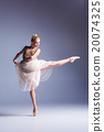 Young beautiful modern style dancer posing on a 20074325