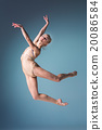 Young beautiful modern style dancer jumping on a 20086584