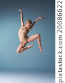 Young beautiful modern style dancer jumping on a 20086622