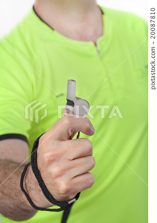 Referee Whistle in a Hand 20087810