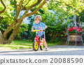 kid boy driving tricycle or bicycle in garden 20088590