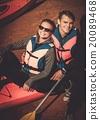 Happy couple on a kayaks 20089468