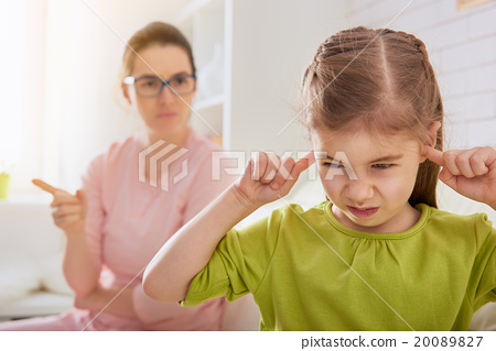 Stock Photo: mother scolds her child