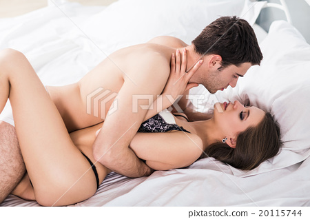 young couple hugging and kissing stock photo 20115744 pixta