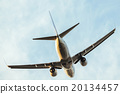 A flying airplane. 20134457