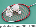 Two worned out badminton shuttlecock with racket 20161708