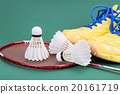 Three badminton shuttlecock with racket and shoes  20161719