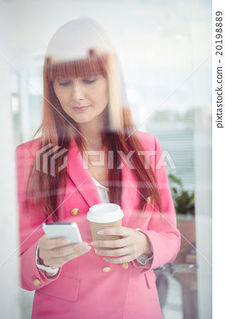 Hipster businesswoman texting with her smartphone 20198889