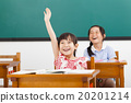 happy school children  raised hands in class 20201214