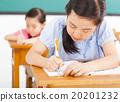 children in classroom with pen in hand 20201232