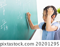 school girl doing math problems on the chalkboard 20201295
