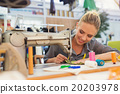 Young woman with sewing machine 20203978