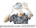 Double exposure of man using the virtual reality 20205497