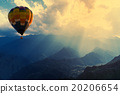 Colorful hot-air balloons flying over the mountain 20206654