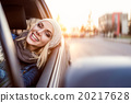 Woman driving a car 20217628