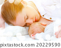 sleeping together and breastfeeding mother and newborn baby in b 20229590