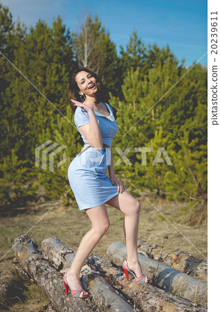 brunet woman in fashion sexy pose  20239611