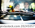 Bride and groom in car 20245057