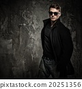 Stylish young man in black coat and sunglasses 20251356