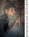 Senior holding a spade 20252869