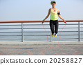 young fitness woman jumping rope at seaside 20258827