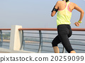 young fitness woman runner running at seaside 20259099