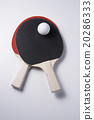 table tennis racket and ping pong ball 20286333