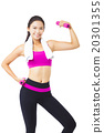 happy young woman exercising with dumbbells 20301355