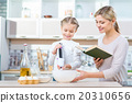 Mother and her daughter cooking  20310656