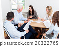 Lawyers having team meeting in law firm 20322765