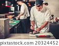 male cooks preparing sushi 20324452