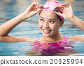 young woman close up portrait in swimming pool 20325994