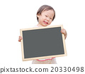 Little girl holding chalkboard over white  20330498