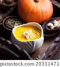 Pumpkin soup with salty popcorn in a ceramic bowl 20331471