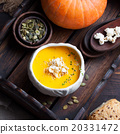 Pumpkin soup with salty popcorn in a ceramic bowl 20331472