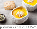 Pumpkin, corn soup with salty popcorn in a bowl  20331525