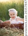 Cute little girl in basket 20357647