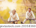 Active seniors riding bike and having fun 20358360