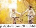 Active seniors riding bike 20358660