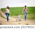 Family with little boy on tricycle in nature 20379501