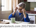 Old woman in the kitchen 20379694